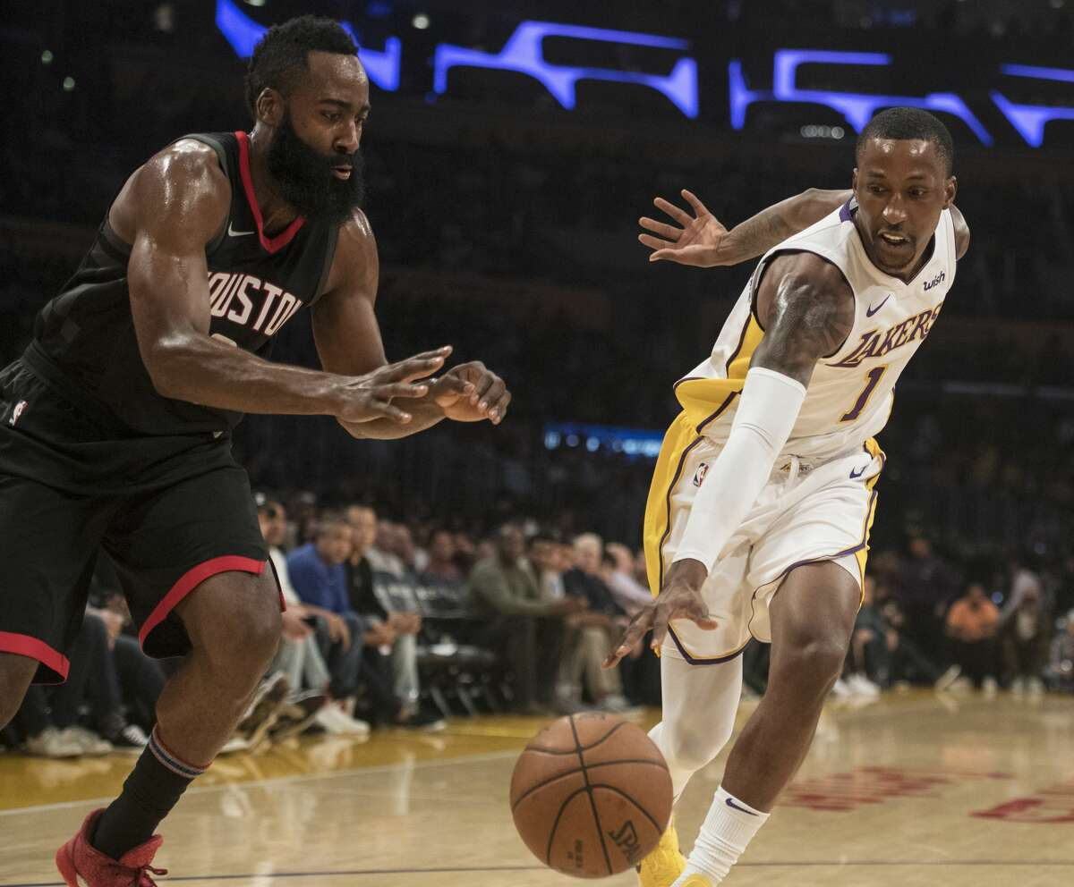 Los Angeles Lakers guard Kentavious Caldwell-Pope, right, steals a pass intended for Houston Rockets guard James Harden during the first half of an NBA basketball game, Sunday, Dec. 3, 2017, in Los Angeles. (AP Photo/Kyusung Gong)