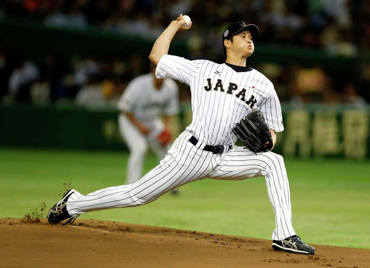 FILE - In this Nov. 19, 2015, file photo, Japan's starter Shohei Otani pitches against South Korea during the first inning of their semifinal game at the Premier12 world baseball tournament at Tokyo Dome in Tokyo. A person familiar with the decision says Major League Baseball owners on Friday, Dec. 1, 2017, have approved a new posting agreement with their Japanese counterparts in a move that allows bidding to start for coveted pitcher and outfielder Shohei Ohtani. The person spoke on condition of anonymity because no announcement had been made. (AP Photo/Toru Takahashi, File) ORG XMIT: NY176