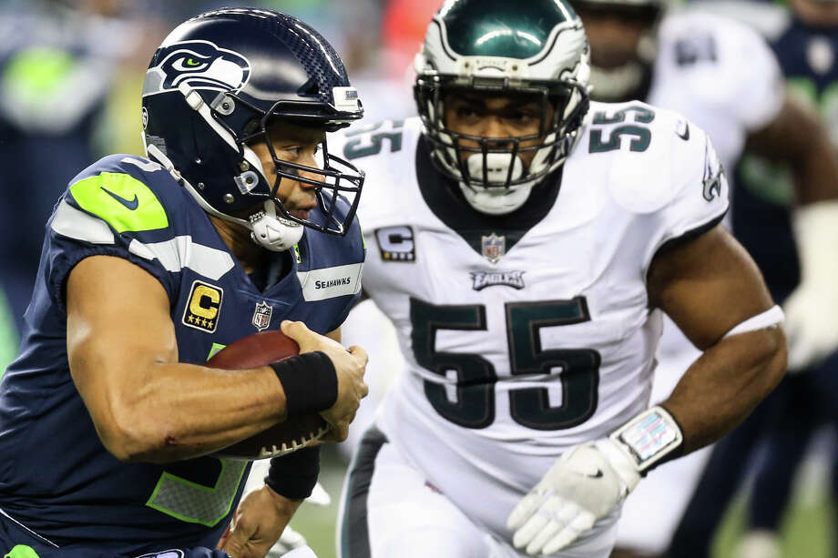 Seahawks quarterback Russell Wilson runs the ball while under pressure from Eagles defensive end Brandon Graham in the second half at CenturyLink Field on Dec. 3, 2017. Check out more photos from the game in the following gallery. Photo: GRANT HINDSLEY, SEATTLEPI.COM / SEATTLEPI.COM