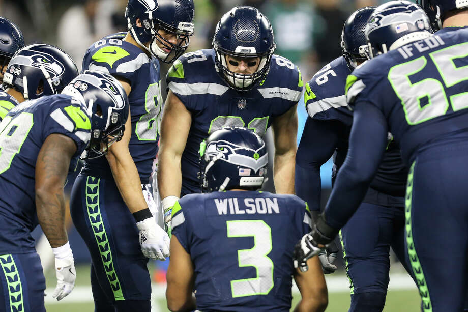 Seahawks quarterback Russell Wilson leads a huddle in the first half against Philadelphia at CenturyLink Field on Dec. 3, 2017. Photo: GRANT HINDSLEY, SEATTLEPI.COM / SEATTLEPI.COM