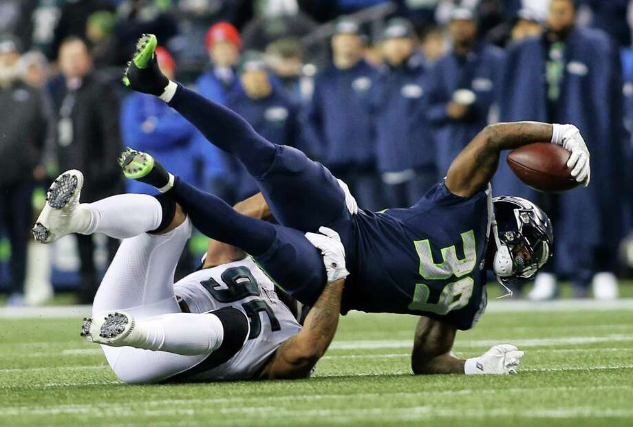 Seahawks running back Mike Davis (39) is tackled by Eagles linebacker Mychal Kendricks (95) during the first half of Seahawks game against the Philadelphia Eagles, Sunday, Dec. 3, 2017, at CenturyLink Field. (Genna Martin/seattlepi.com) Photo: GENNA MARTIN, SEATTLEPI / SEATTLEPI