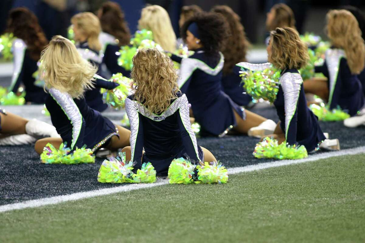 The SeaGals perform during the Seahawks game against the Philadelphia Eagles, Sunday, Dec. 3, 2017, at CenturyLink Field. (Genna Martin/seattlepi.com)