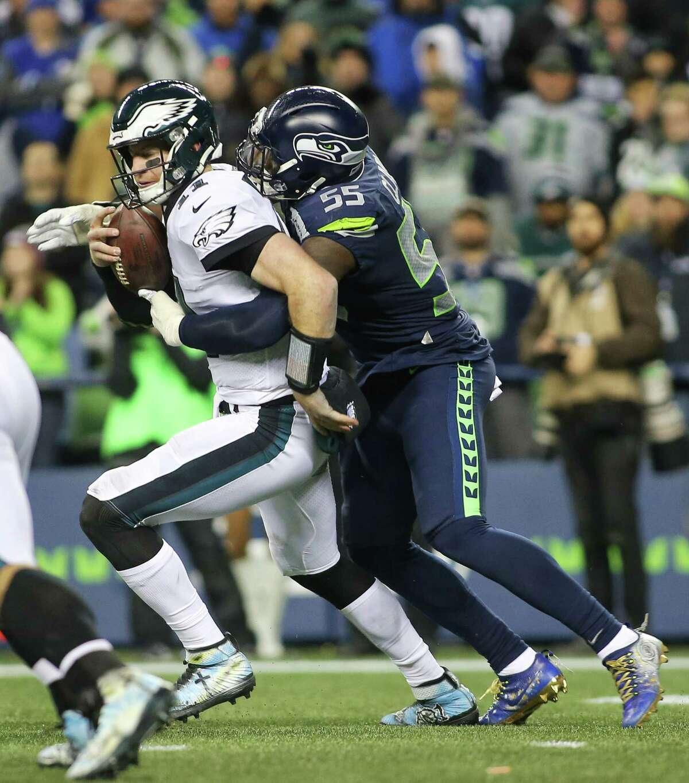Seahawks defensive lineman Frank Clark sacks Eagles quarterback Carson Wentz during the Seahawks game against the Philadelphia Eagles, Sunday, Dec. 3, 2017, at CenturyLink Field. (Genna Martin/seattlepi.com)