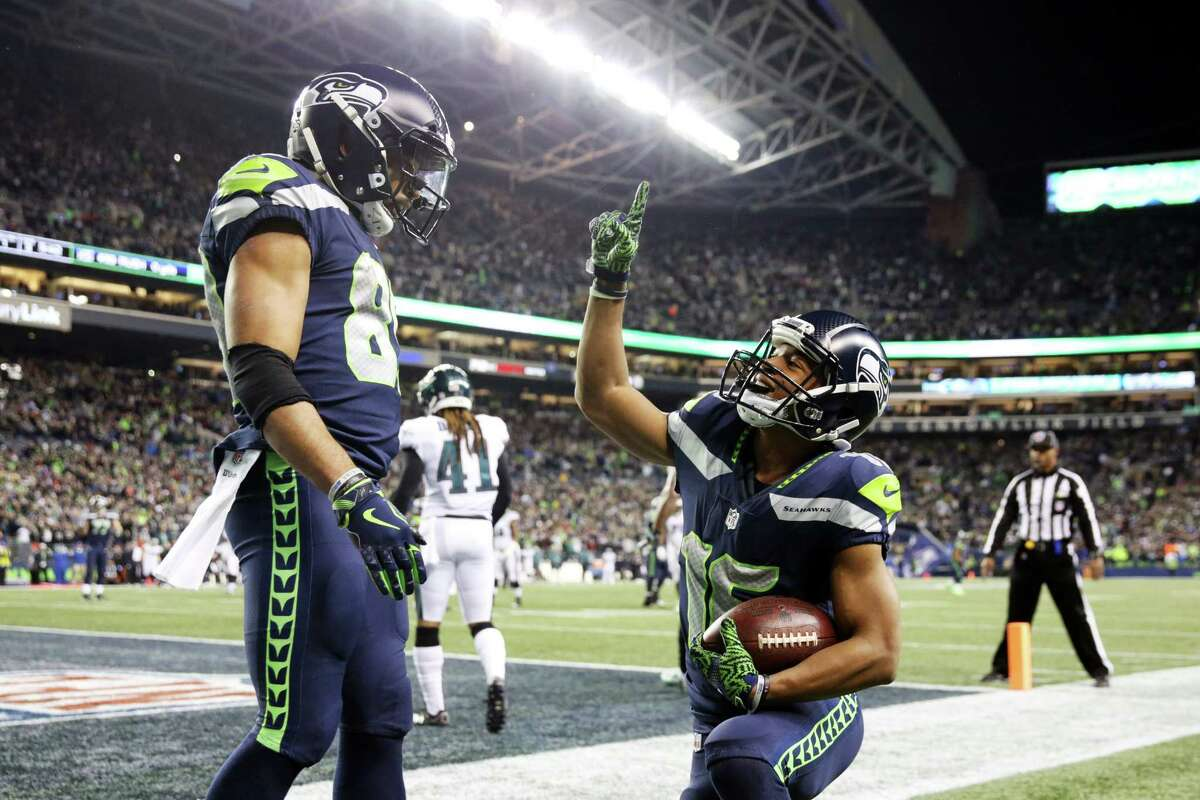 Seahawks wide receiver Tyler Lockett, right, celebrates his third quarter touchdown with Doug Baldwin, left, during the Seahawks game against the Philadelphia Eagles, Sunday, Dec. 3, 2017, at CenturyLink Field. (Genna Martin/seattlepi.com)