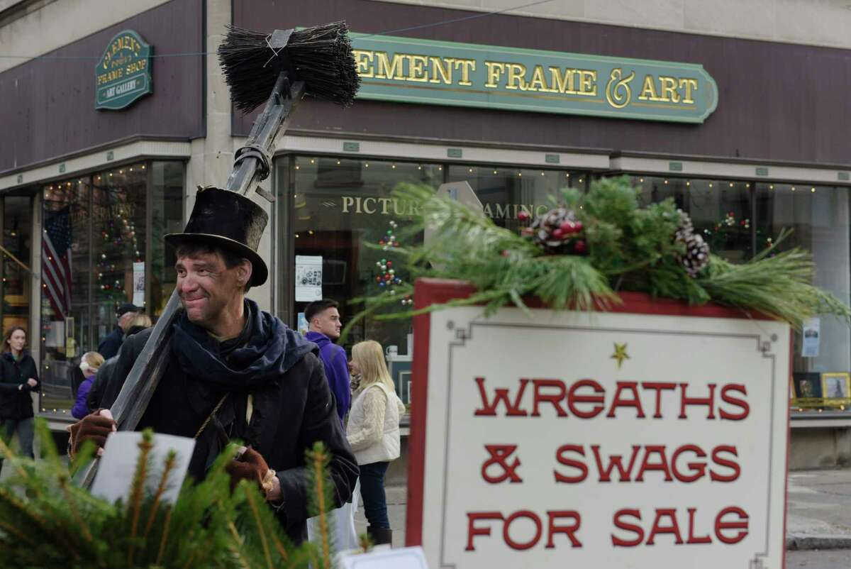 Mike Noble, dressed in period clothing as a chimney sweeper, helps to sell Christmas wreaths to raise money for Joseph's House at the 35th Annual Troy Victorian Stroll on Sunday, Dec. 3, 2017, in Troy, N.Y. For the past five years Ernie Piazza has made wreaths and then he and his friends dress in period clothing and sell the wreaths at the stroll. Last year they raised $2,000 for Joseph's House, Piazza said he thinks he'll over that this year. (Paul Buckowski / Times Union)