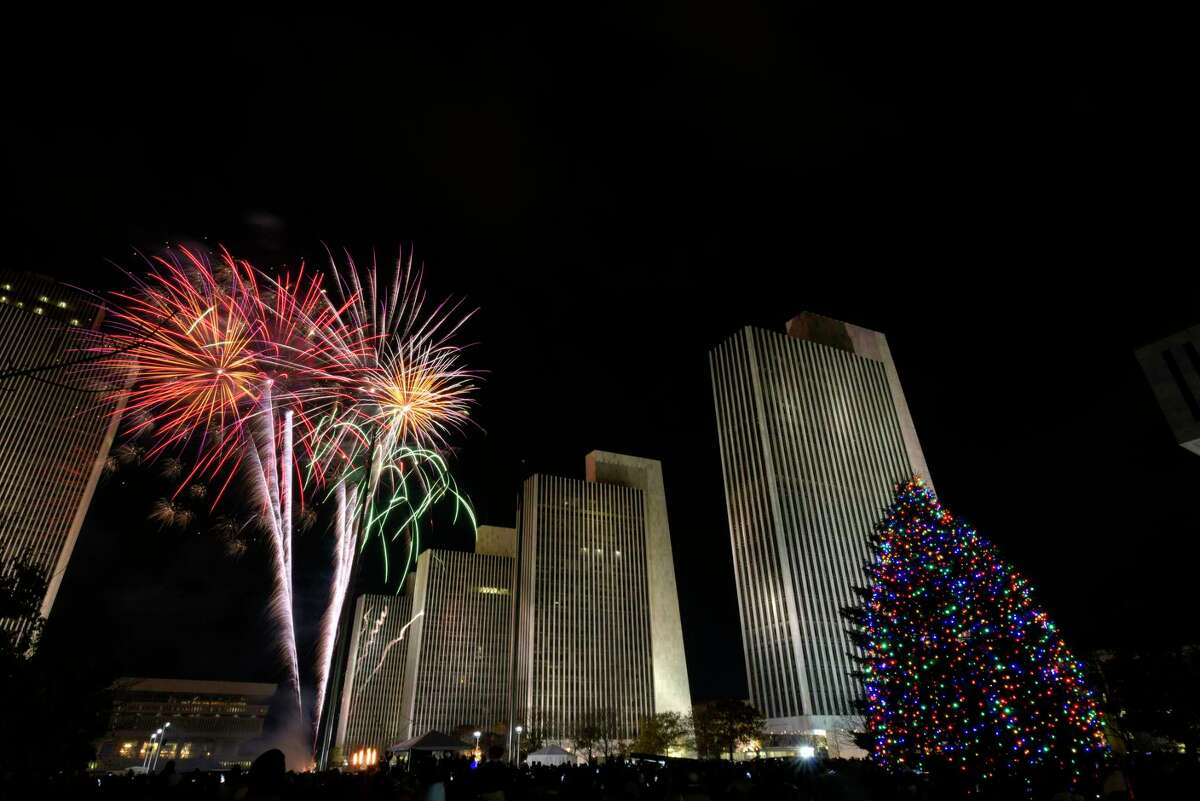 Fireworks explode in the sky during the New York State Holiday Tree Lighting ceremony at the Empire State Plaza on Sunday, Dec. 3, 2017, in Albany, N.Y. on Sunday, Dec. 3, 2017, in Albany, N.Y. (Paul Buckowski / Times Union)