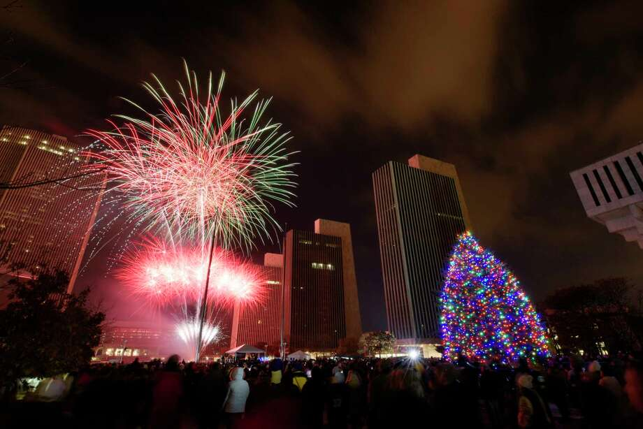 Fireworks explode in the sky during the New York State Holiday Tree Lighting ceremony at the Empire State Plaza on Sunday, Dec. 3, 2017, in Albany, N.Y. on Sunday, Dec. 3, 2017, in Albany, N.Y.    (Paul Buckowski / Times Union) Photo: PAUL BUCKOWSKI / 20042146A