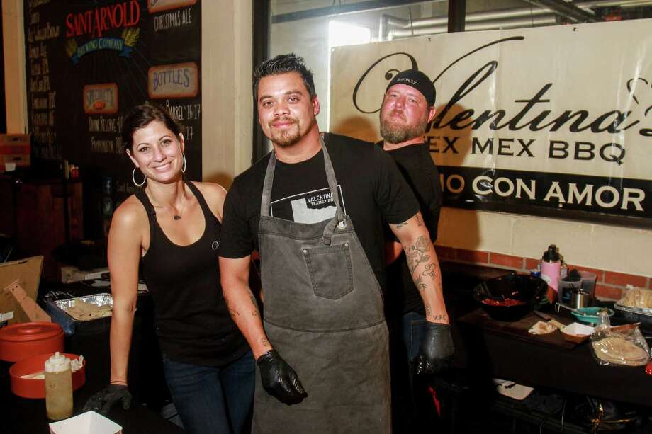 Modesty Vidal, from left, chef Miguel Vidal and Scott Fogle of Valentina's Tex Mex BBQ, at the HOU-ATX BBQ Throwdown at the Saint Arnold Brewing Co. Photo: Gary Fountain, For The Chronicle/Gary Fountain / Copyright 2017 Gary Fountain