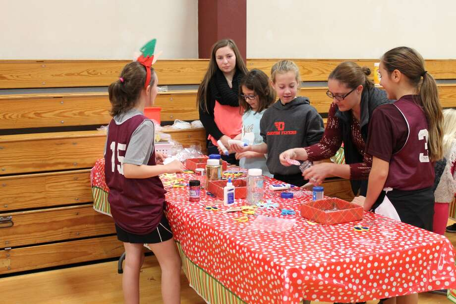 Santa Claus drew a large crowd Saturday morning for his annual breakfast appearance St. Mary's Catholic School. The event served as a fundraiser for next year's seventh-grade class trip to Space Camp in Huntsville, Ala. In addition to photo opportunities with Santa and a pancake and sausage breakfast, the event also featured games, crafts, a bake sale and a raffle. Photo: Heather Adams • For The Intelligencer