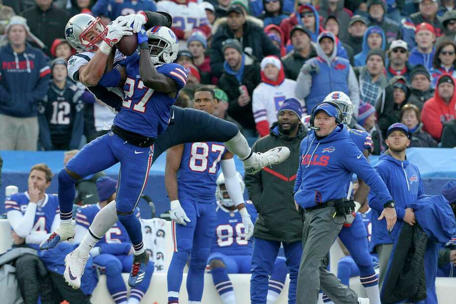 New England Patriots tight end Rob Gronkowski, left, makes a catch as Buffalo Bills cornerback Tre'Davious White (27) defends during the second half of an NFL football game, Sunday, Dec. 3, 2017, in Orchard Park, N.Y. Bills head coach Sean McDermott, right, looks on during the play. (AP Photo/Adrian Kraus) Photo: Adrian Kraus, Associated Press / FR171451 AP