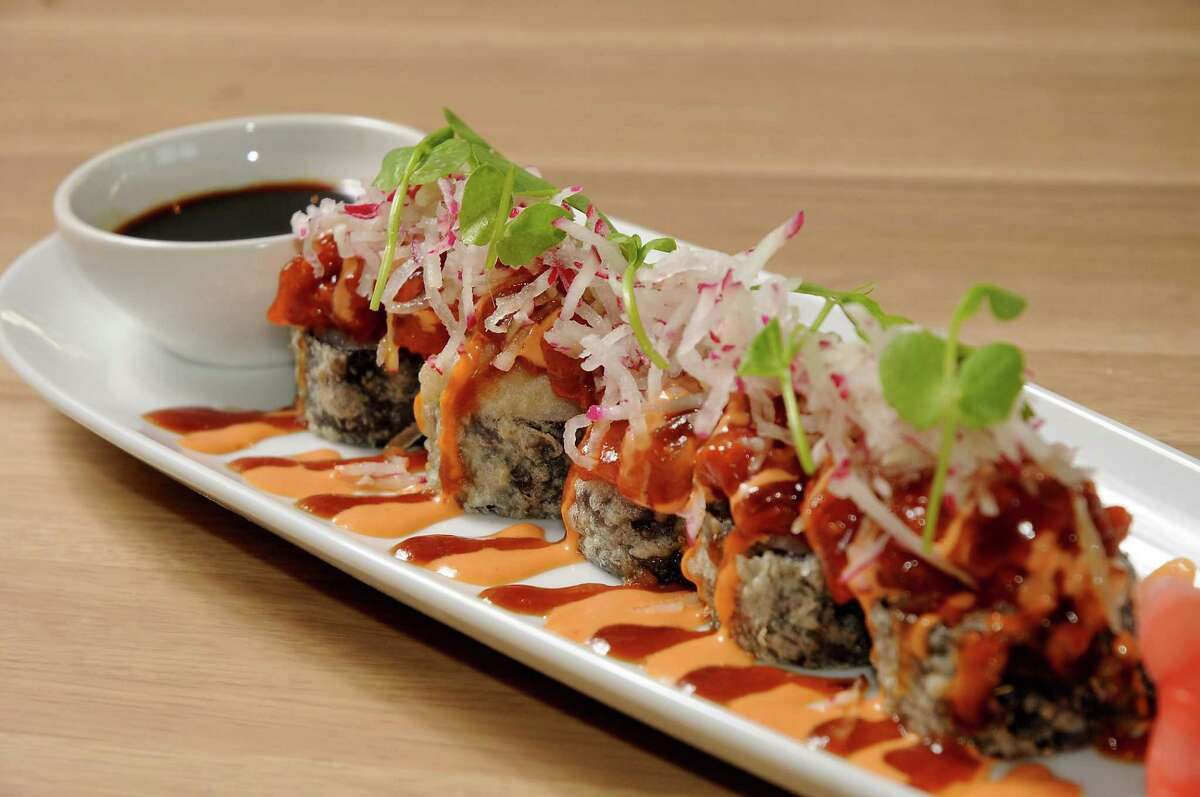 The spicy tuna roll-hand-rolled tempura sushi, spicy sushi grade ahi and soy sauce at Moxie's Grill & Bar on Westheimer.