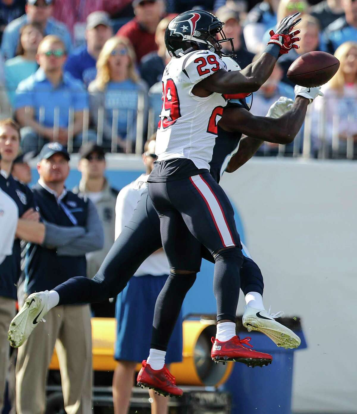 Houston Texans free safety Andre Hal (29) breaks up a pass intended for Tennessee Titans wide receiver Corey Davis (84) during the second quarter of an NFL football game at Nissan Stadium on Sunday, Dec. 3, 2017, in Nashville.
