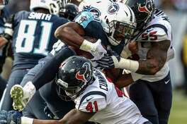 Houston Texans inside linebacker Zach Cunningham (41) and inside linebacker Benardrick McKinney (55) hit Tennessee Titans running back DeMarco Murray (29) at the line of scrimmage during the third quarter of an NFL football game at Nissan Stadium on Sunday, Dec. 3, 2017, in Nashville.