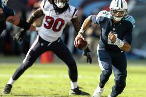 Tennessee Titans quarterback Marcus Mariota (8) is forced out of the pocket by Houston Texans outside linebacker Jadeveon Clowney (90) during the second quarter of an NFL football game at Nissan Stadium on Sunday, Dec. 3, 2017, in Nashville.