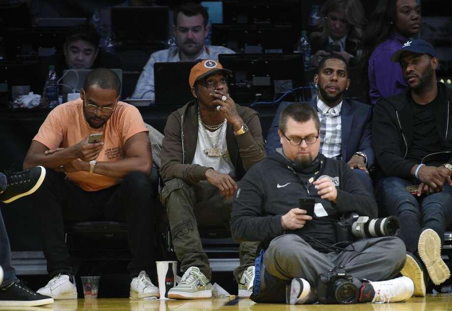 PHOTOS: A look at the celebrities in the crowd for the Rockets' win over the Lakers on Sunday nightRapper Travis Scott attends the Houston Rockets and Los Angeles Lakers basketball game at Staples Center December 3, 2017 in Los Angeles, California.Browse through the photos above for a look at the stars in the crowd for the Rockets' win on Sunday night in Los Angeles. Photo: Kevork S. Djansezian/Getty Images