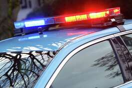 Seattle police car responds to an incident (Genna Martin, seattlepi.com)