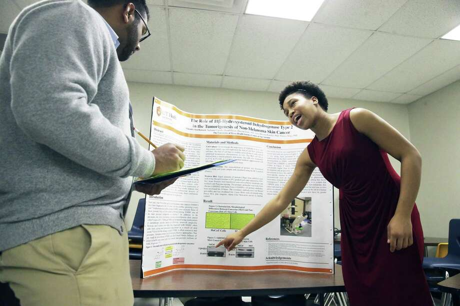 Chamberlyn Barnett explains her research in skin cancer treatment to judge Shyam Nana as John Jay High School hosts a science fair at the school on December 2, 2017 Photo: Tom Reel, Staff / San Antonio Express-News / 2017 SAN ANTONIO EXPRESS-NEWS