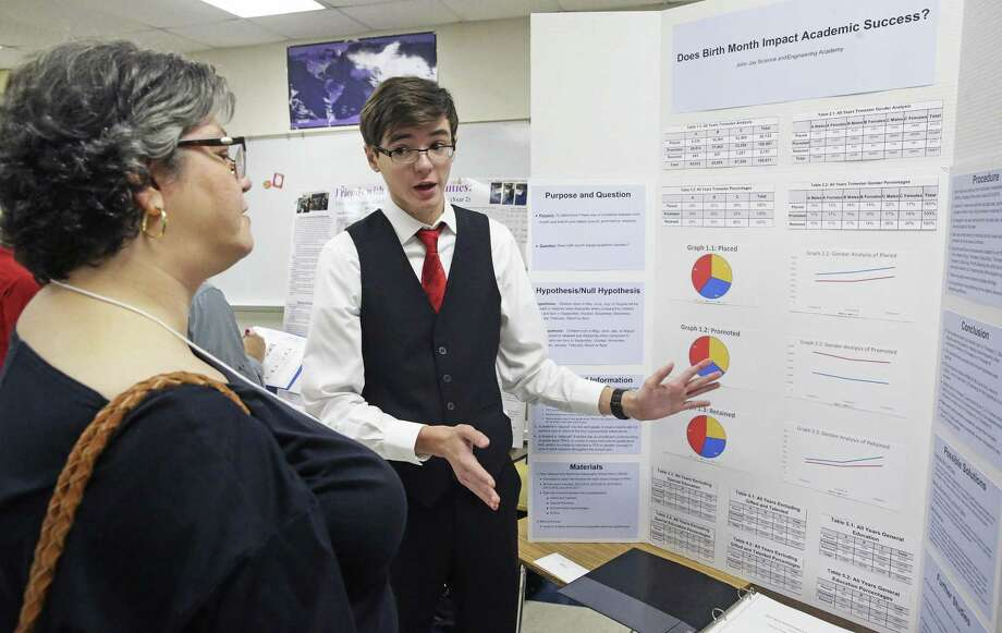 "Trevor Erwin talks about his study, ""Does Birth Month Impact Academic Success"", to judge Stephanie Loalada as John Jay High School hosts a science fair at the school on Dec. 2. Photo: Tom Reel /San Antonio Express-News / 2017 SAN ANTONIO EXPRESS-NEWS"