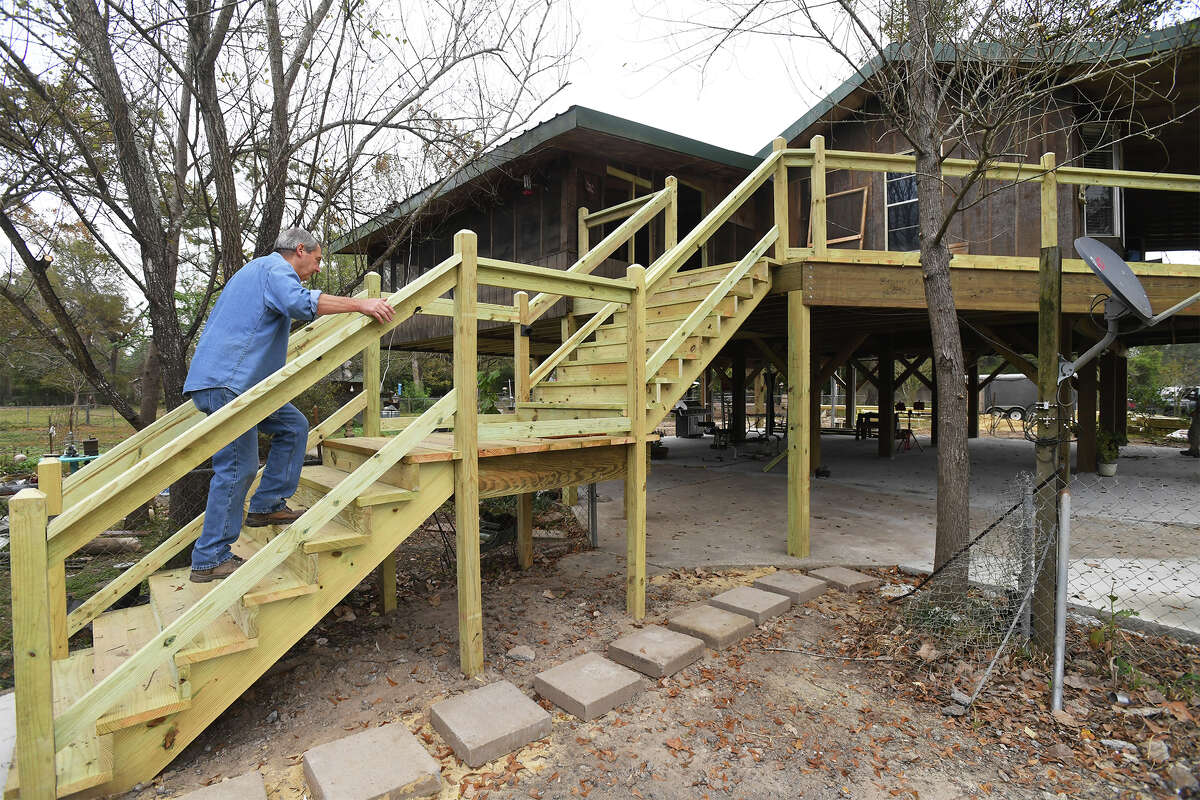 Tommy Spears walks up the stairs to his Deweyville house after recently raising it 9 feet in an attempt to beat the future flood waters. Photo taken Wednesday, November 29, 2017 Guiseppe Barranco/The Enterprise
