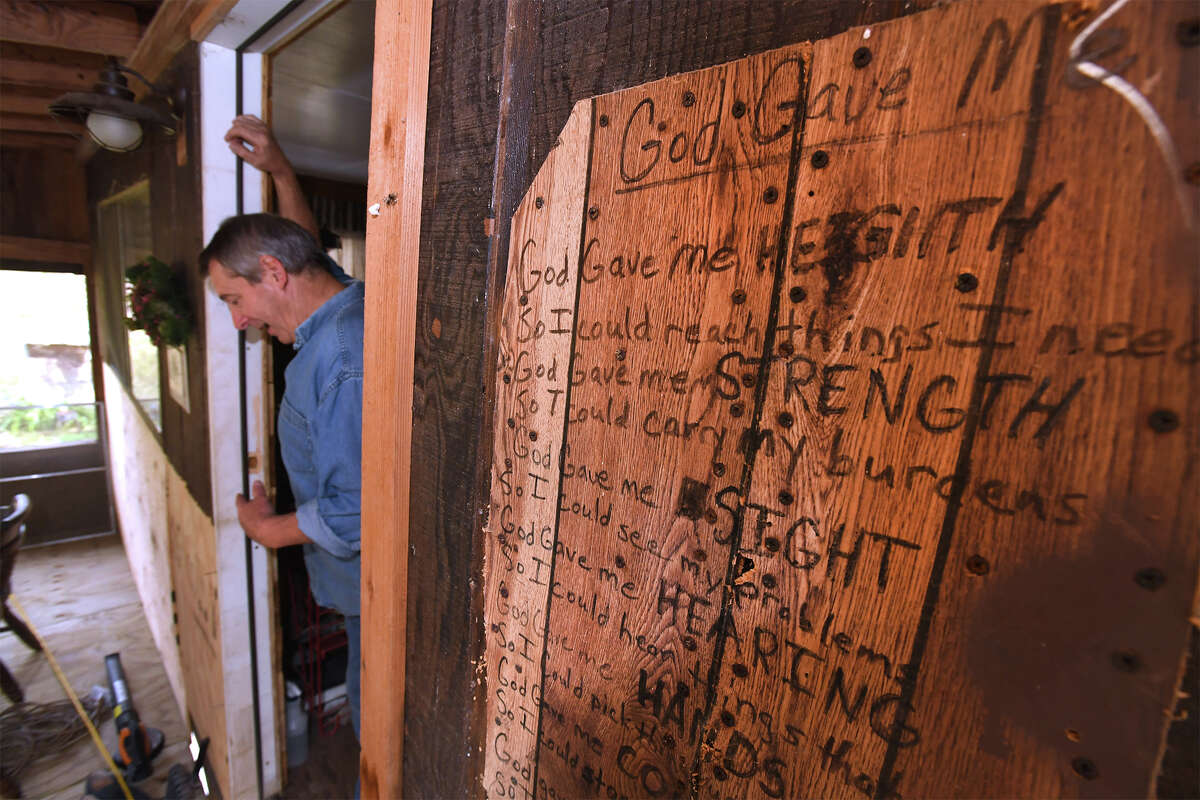 Tommy Spears stands in the doorway at his Deweyville house on Monday. Spears recently had is house raised 9 feet in an attempt to beat the future flood waters. Photo taken Wednesday, November 29, 2017 Guiseppe Barranco/The Enterprise