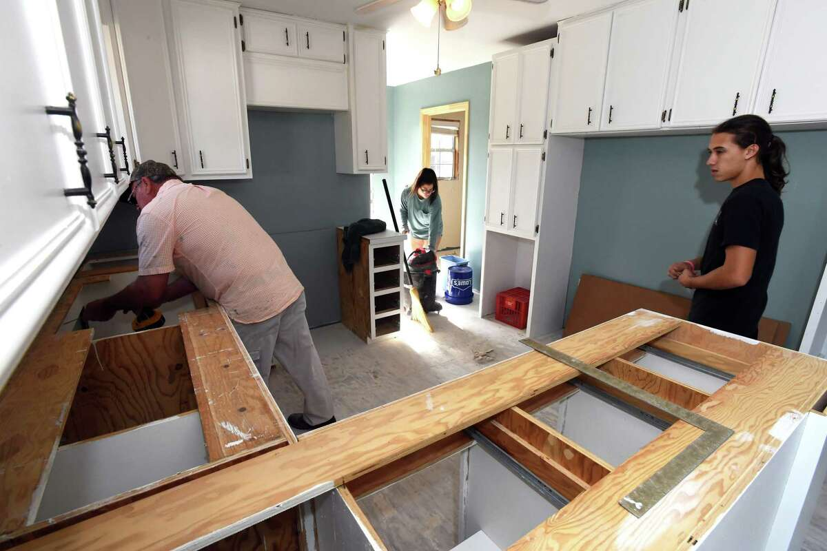 From left, Mike Daidle, Krystal Brown and Sean Apollonio work on Annette Smart's mother's Deweyville kitchen on Wednesday. Photo taken Wednesday, November 29, 2017 Guiseppe Barranco/The Enterprise