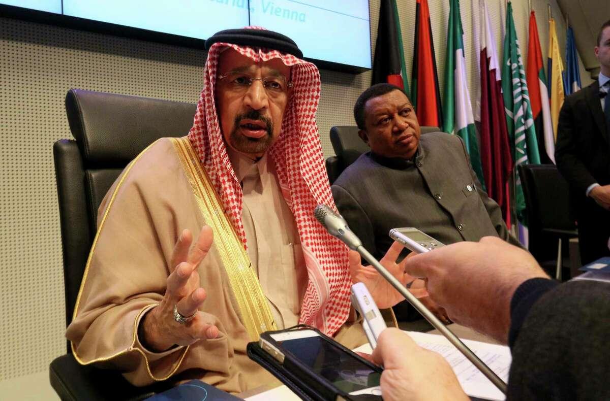 Khalid al-Falih, Saudi Arabia's minister of energy and chairman of Saudi Aramco, and Nigeria's Mohammad Sanusi Barkindo, OPEC's secretary-general, speak to journalists before the cartel's meeting last week in Vienna, Austria.
