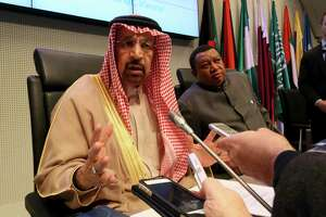Khalid al-Falih, Saudi Arabia's minister of energy and chairman of Saudi Aramco, and Nigeria's Mohammad Sanusi Barkindo, OPEC's secretary-general, speak to journalists before the cartel's meeting last week in Vienna, Austria.
