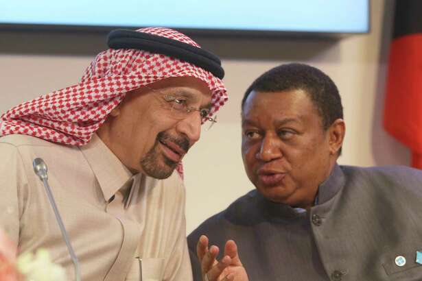 Khalid Al-Falih Minister of Energy, Industry and Mineral Resources of Saudi Arabia and Mohammad Sanusi Barkindo, from left, OPEC Secretary General of Nigeria attend a news conference after a meeting of the Organization of the Petroleum Exporting Countries, OPEC, at their headquarters in Vienna, Austria, Thursday, Nov. 30, 2017. (AP Photo/Ronald Zak)