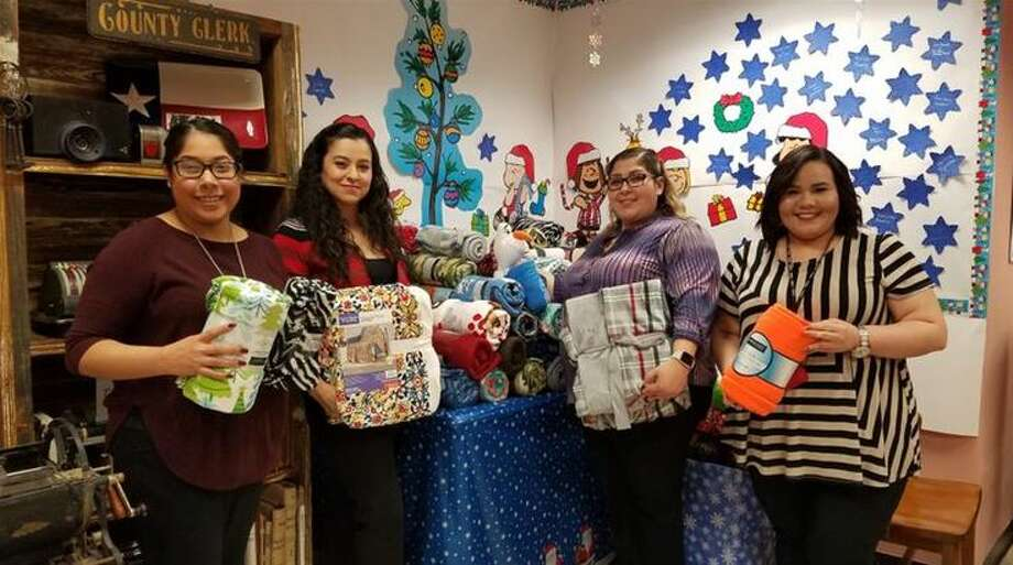 Webb County Clerk's Office employees Vanessa Zapata, Lucy Perez, Brigette Garay and Kassandra Cavazos invite the community to donate during the office's 11th Annual Blanket Drive. Monetary and blanket donations are welcomed at the county clerk's office located at 1110 Victoria St. Suite 201. The deadline to donate is Dec. 8. Photo: Courtesy
