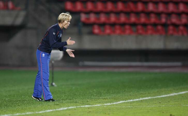 Netherlands' head coach Vera Pauw cheers her team during their quarter final Women's Euro 2009 soccer match against France in Tampere, Finland, Thursday evening, Sept. 3, 2009. The Women's European soccer championships take place in Finland from Aug. 23 to Sept. 10, 2009. (AP Photo/Matthias Schrader)