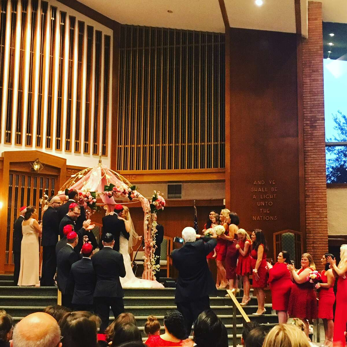 Erica Rose and Charles Sanders tie the knot at Congregation Emanu El on Sunday, December 3.