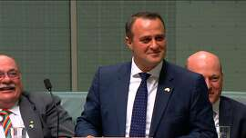 "In this TV grab released by Australian Parliament via Seven News, Australian lawmaker Tim Wilson (C) proposes to his partner Ryan Bolger (not pictured) in parliament in Canberra on December 4, 2017.  Wilson popped the question in parliament, proposing to his partner moments after a bill paving the way for same-sex marriage was introduced. Wilson, who has reportedly been engaged to Bolger for nine years, fought back tears as he thanked his fiance for enduring a marriage debate that ""has been the soundtrack to our relationship"".    / AFP PHOTO / Australian Parliament via Seven News / - / RESTRICTED TO EDITORIAL USE - MANDATORY CREDIT "" AFP PHOTO / Australian Parliament via Seven News "" - NO MARKETING NO ADVERTISING CAMPAIGNS - NO RESALE - NO DISTRIBUTION TO THIRD PARTIES - 24 HOURS USE - NO ARCHIVES -/AFP/Getty Images"