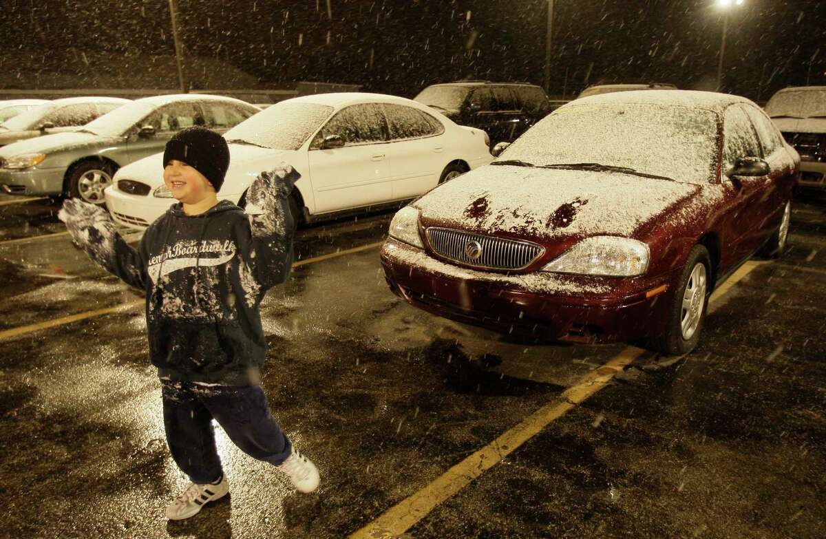 Mario Hernandez Jr., 6, enjoys his first snow fall as he plays with the snow at Affordable Cars & Trucks, 5715 I-45, where his dad, Mario Hernandez, Sr. works shown Wednesday, Dec. 10, 2008, in Houston.