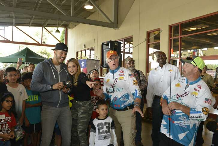 Houston Astros' World Series champion Carlos Correa and his fiancŽ Daniella Rodriguez in partnership with Vamos A Pescarª share the joy of reeling in a #FirstCatch with over 100 families at Bass Pro Shops Katy on Saturday, Dec. 2, 2017, in Katy, Texas. (Anthony Rathbun/AP Images for Bass Pro Shops)
