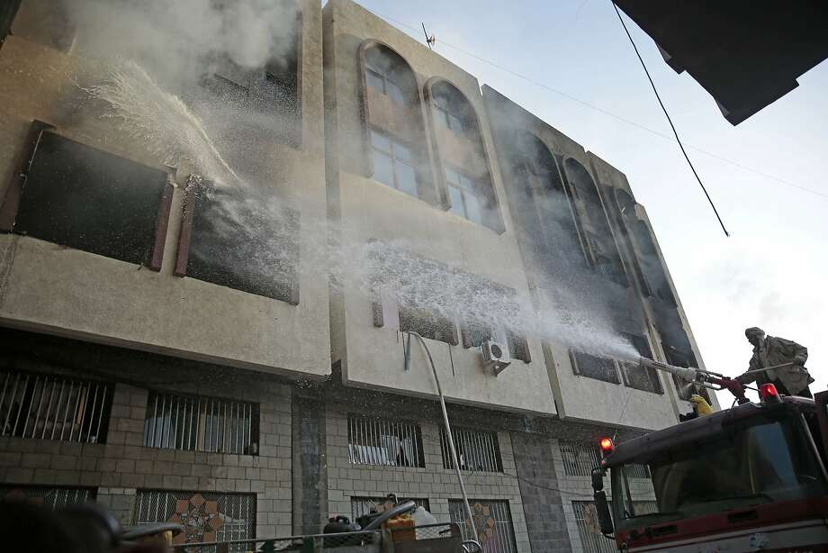 Firefighters hose a building in Sanaa the capital of Yemen. Former President Ali Abdullah Saleh was killed Monday