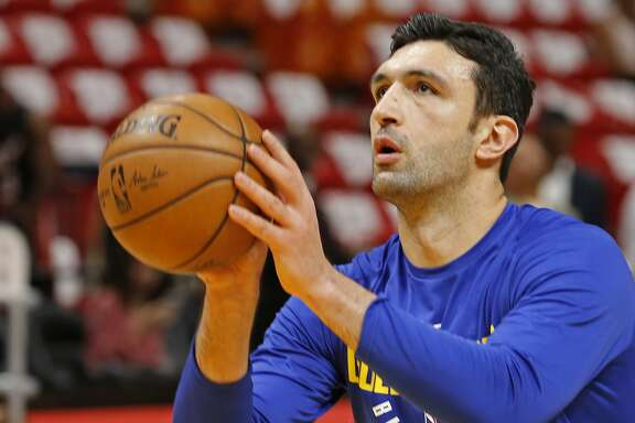 Golden State Warriors center Zaza Pachulia (27) shoots during warmups before the Warriors played against the Miami Heat in an NBA basketball game, Sunday, Dec. 3, 2017, in Miami. (AP Photo/Joe Skipper)