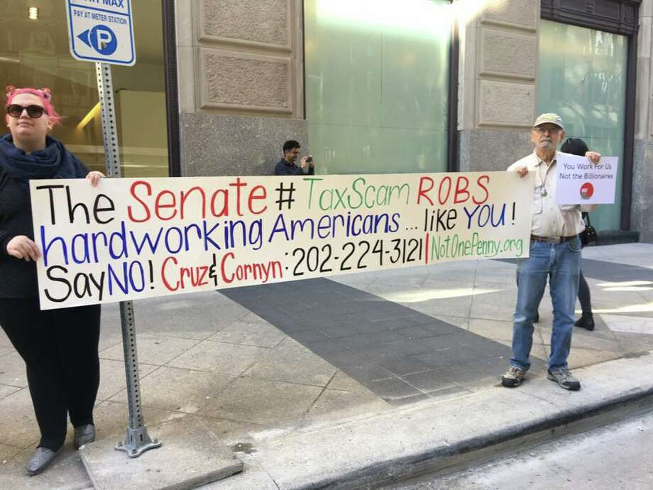A number of organizations, including Indivisible Houston, rally together outside Ted Cruz's office Monday in part of a Nation Day of Action at Senate offices across the country to reject the Senate Tax Bill. Photo: Courtesy Photo