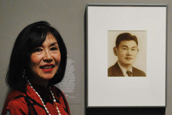 Karen Korematsu pose near photographs of their father Fred Korematsu during a presentation of his portrait to the National Portrait Gallery on February 2, 2012 in Washington, DC. Fred Korematsu was a US citizen of Japanese ancestry who was imprisoned for defying a relocation order.