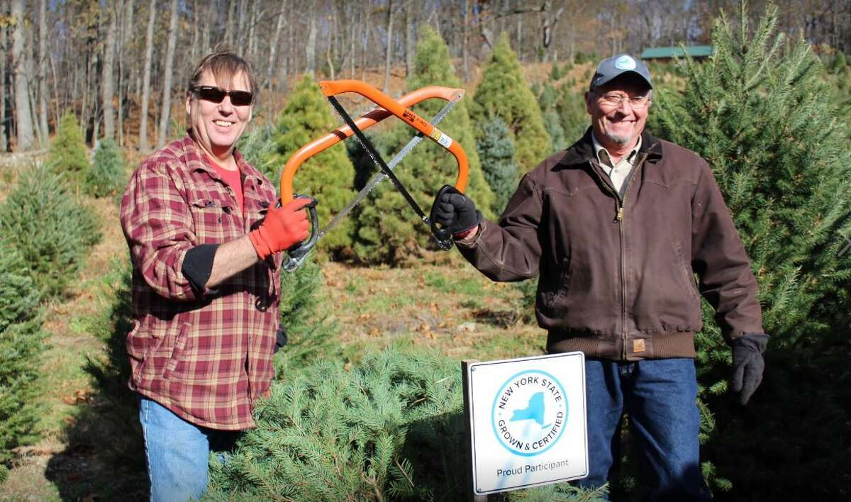 State Agriculture and Markets Commissioner Richard Ball, right, with a Christmas tree farmer