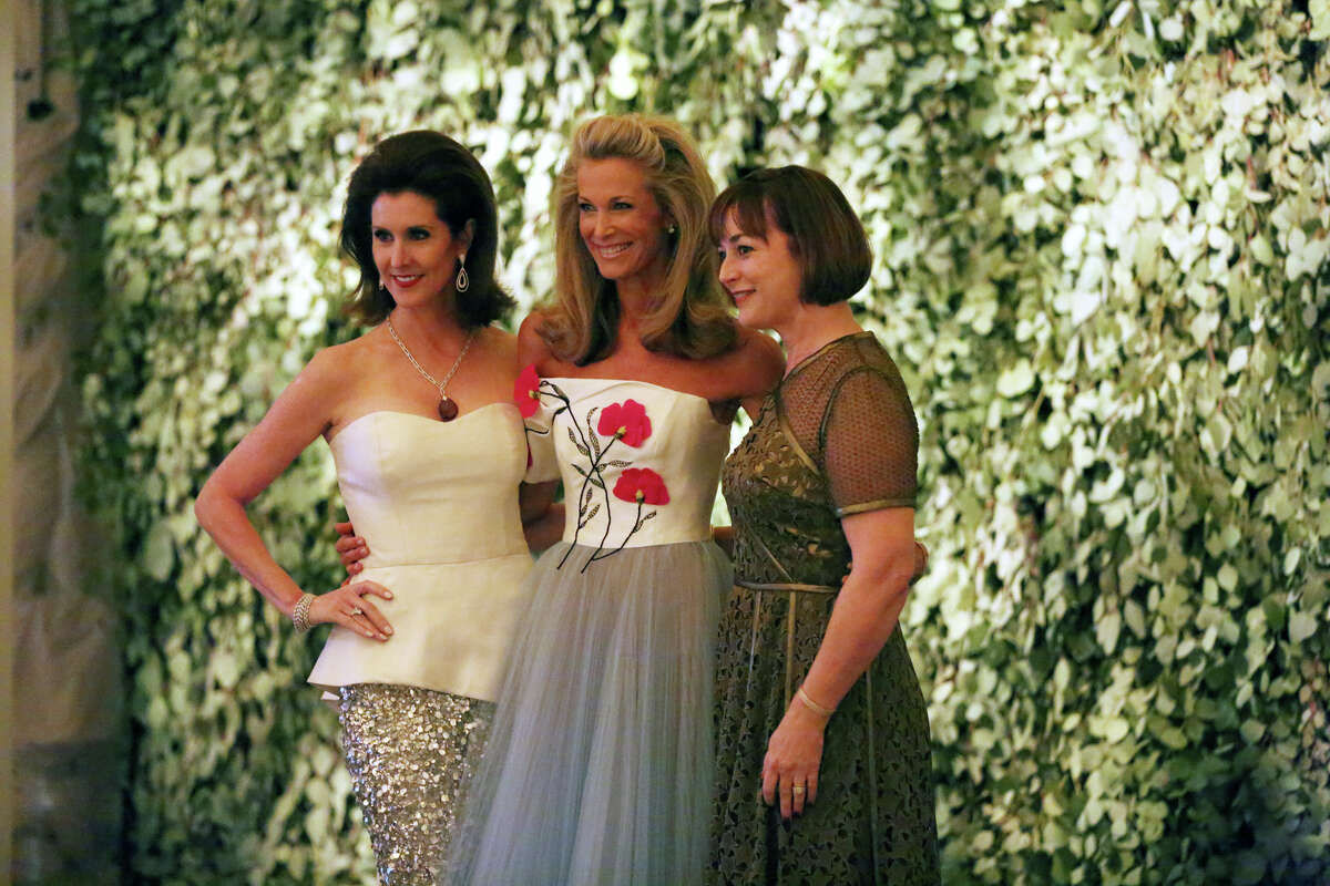 """Co-chair Phoebe Tudor, from left, Menil Foundation president Janet Hobby and co-chair Leigh Smith pose in front of the garden-like backdrop at """"Luminous,"""" the Menil Collection's 30th Anniversary Ball."""
