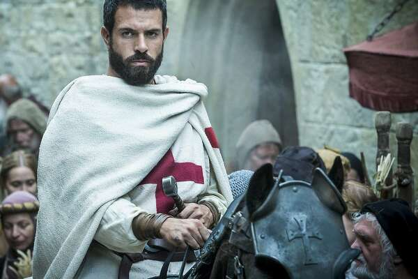 "Tom Cullen, who once courted Lady Mary on ""Downton Abbey,"" is now the leader of a brave band of Knights Templar in the History Channel's 10-part series, ""Knightfall,"" premiering Wednesday. (History Channel)"