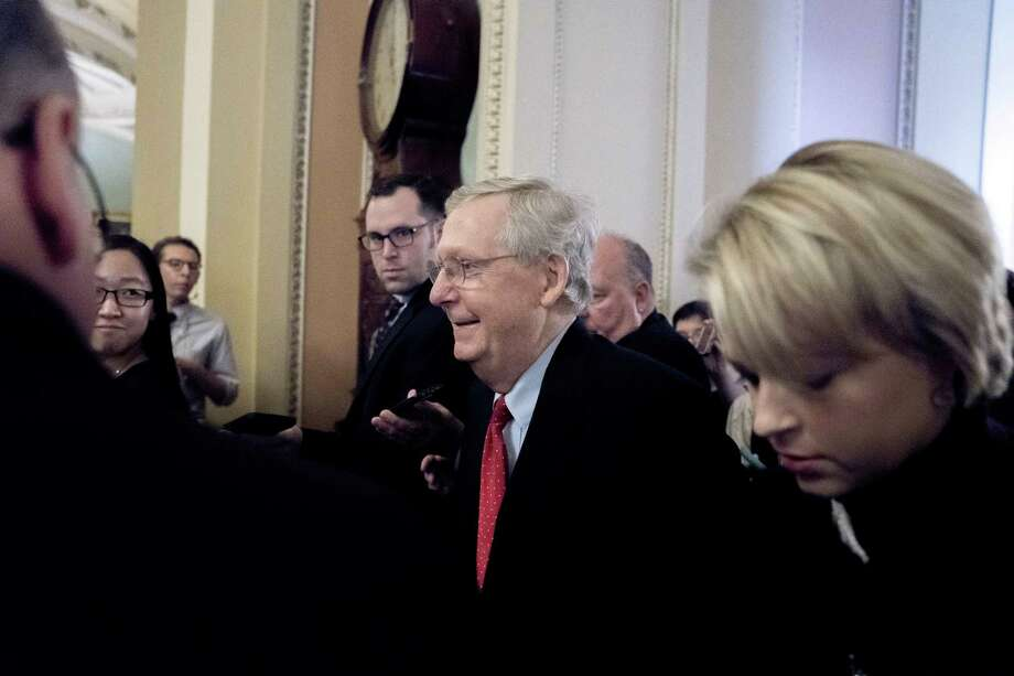 """Telling reporters """"we have the votes,"""" Senate Majority Leader Mitch McConnell, R-Ky., walks to the chamber after a closed-door meeting with Republican lawmakers to advance the GOP overhaul of the tax code, on Capitol Hill in Washington, Friday, Dec. 1, 2017. Photo: Andrew Harnik /Associated Press / Copyright 2017 The Associated Press. All rights reserved."""
