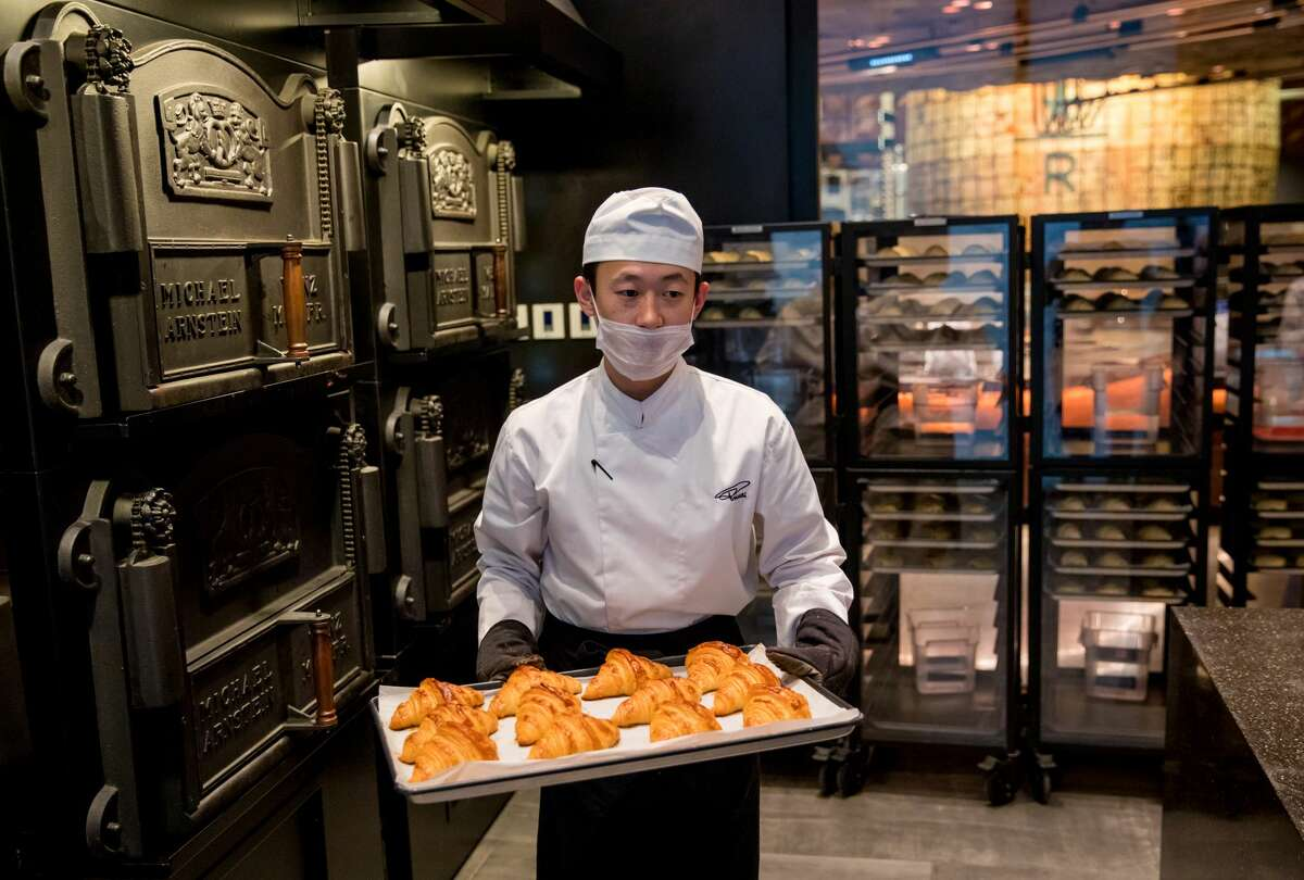 A baker works in the Princi bakery at the new Starbucks Roastery in Shanghai, China. Photographed on Friday, December 1, 2017. (Joshua Trujillo, Starbucks) The new Starbucks Roastery in Shanghai.