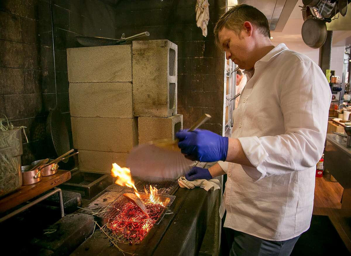 Chef Josh Skenes cooks Bonito at Saison in San Francsico, Calif., on Wednesday, May 14th, 2014.
