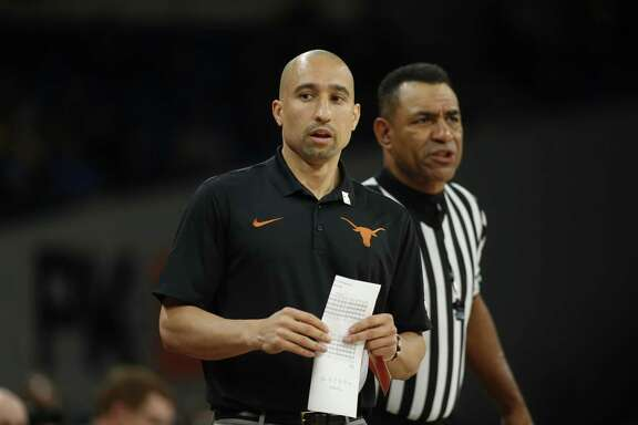 Texas head coach during an NCAA college basketball game during the Phil Knight Invitational tournament in Portland, Ore., Thursday, Nov. 23, 2017. (AP Photo/Timothy J. Gonzalez)