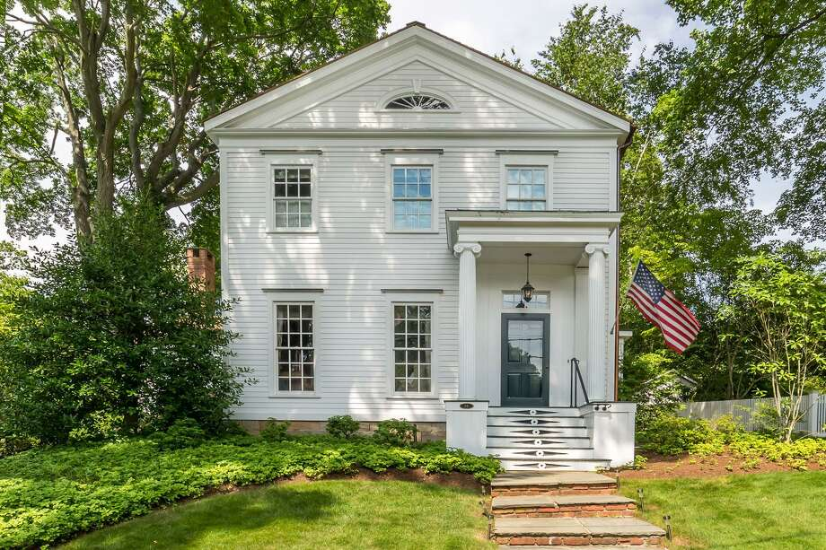 The antique colonial house at 69 Rose Hill Road was built in 1804 but was completely remodeled to include modern amenities.