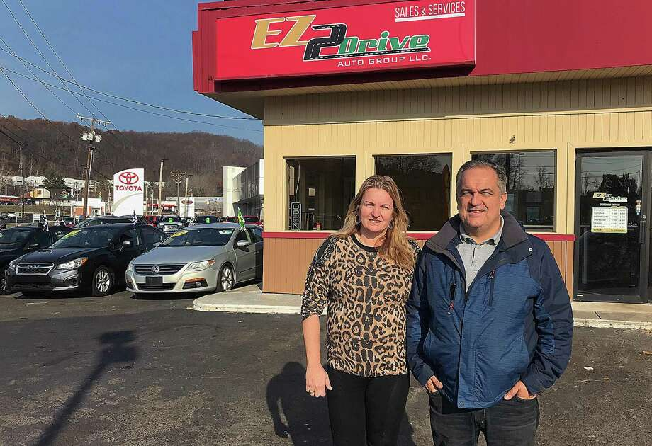 Eda and John Fieschi stand in the lot of their recently opened business, EZ2Drive Auto Group, at 79 Fedral Road in Danbury, Conn., on Monday, Dec. 4, 2017. Photo: Chris Bosak / Hearst Connecticut Media / The News-Times
