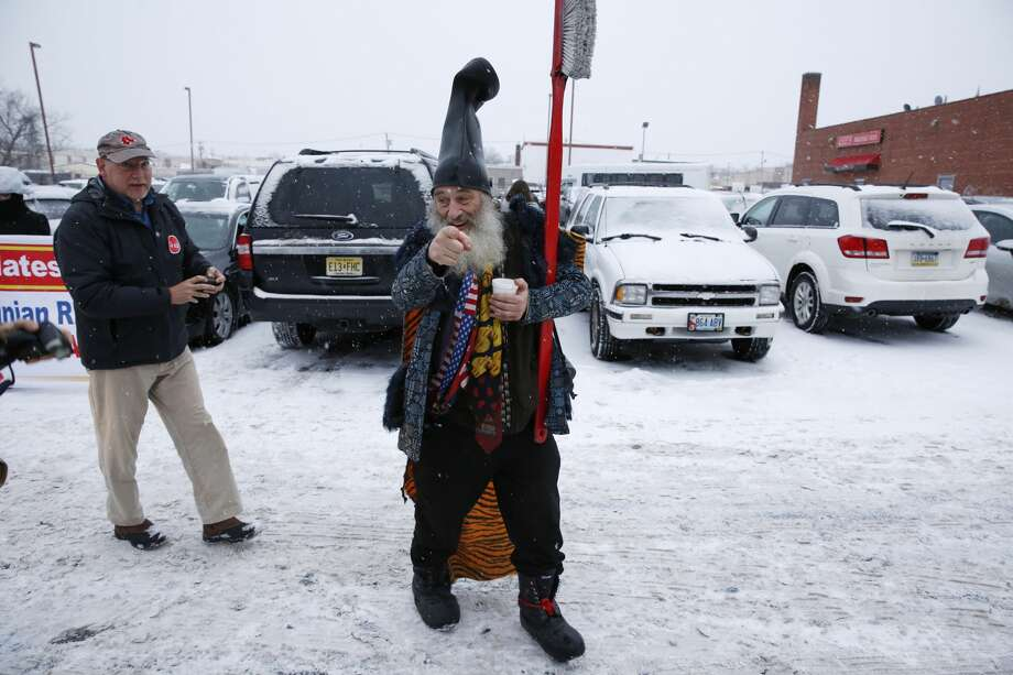 "FILE — US presidential candidate ""Vermin Supreme"" campaigns near an American Legion post on February 8, 2016 in Manchester, New Hampshire.  Vermin Supreme, who does not disclose his birth name, a local political activist and satirist who comments on the political process through surreal public stunts, has been campaigning in presidential primaries since 2004. Photo: DOMINICK REUTER/AFP/Getty Images"