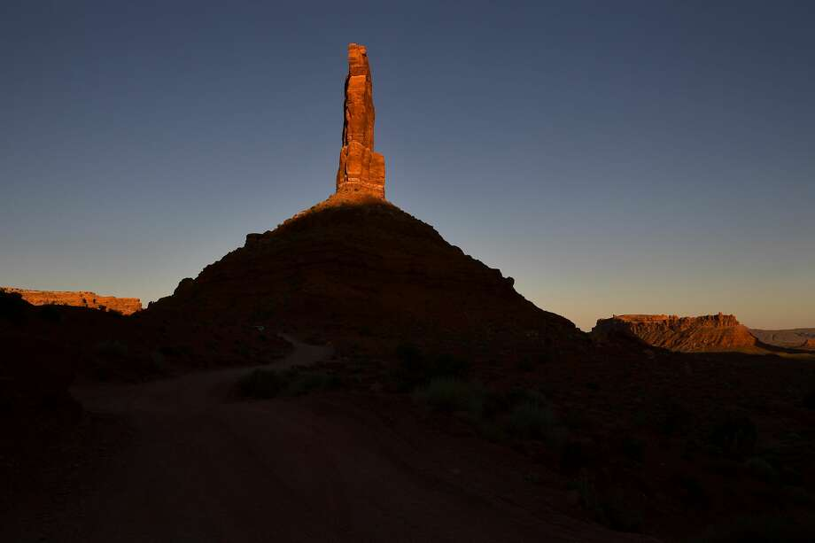 One of the towering pinnacles in Valley of the Gods within the Bears Ears National Monument is illuminated as the sun sets June 12, 2017 near Bluff, Utah. Photo: The Washington Post/The Washington Post/Getty Images