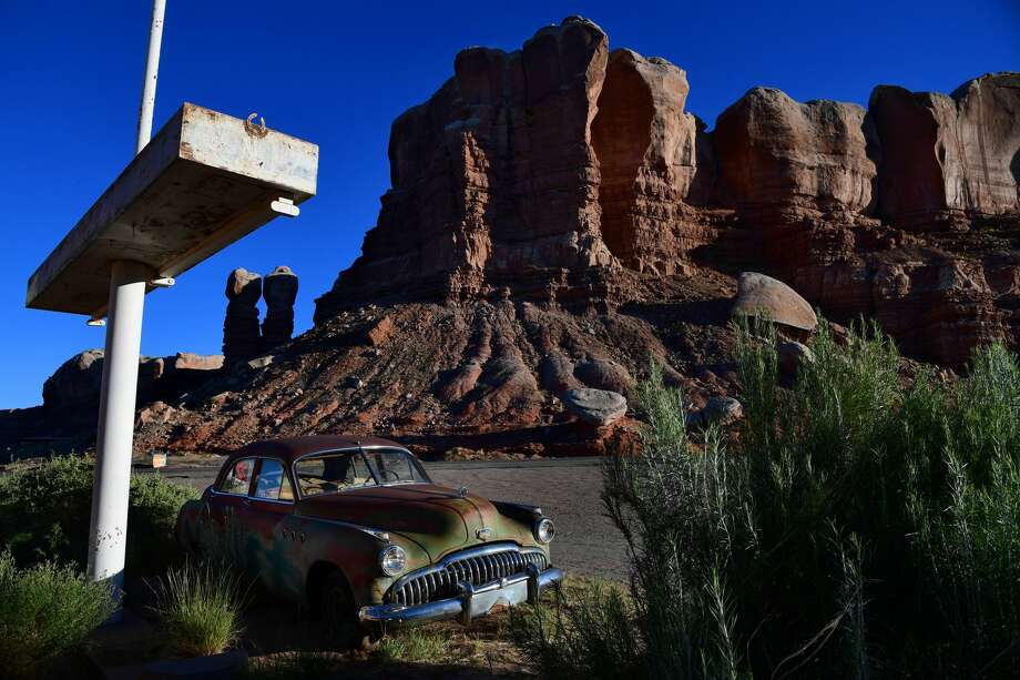 A former gas station turned into an art gallery called Cow Canyon Trading Post features a vintage Buick Super Eight with a backdrop of Twin Rocks, part of Bears Ears National Monument seen June 13, 2017 in Bluff, UT. Photo: The Washington Post/The Washington Post/Getty Images